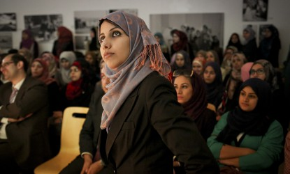 Palestinian Mariam Abultewi, age 25, who won the Gaza Startup Weekend two years ago, and is a participating as a mentor and a Big Sister for the event, watches a lecture, at a pre-weekend event, inside the French Cultural Center, in Gaza City, Gaza Strip, Wednesday, June 18, 2014. The Gaza Startup Weekend is in it's fourth year, and gives young Palestinians the chance to get their company ideas funding, if they win the final event. This year 600 Gazans applied and 150 were accepted to attend. Of those, 25 go on to the second round. People whose ideas weren't selected are encouraged to join teams and learn how to build a startup. Women are a large part of the weekend, and this year there is a Big Sister/Little Sister program to help mentor some of them, of which Abultewi is apart of. (Photo credit/Tara Todras-Whitehill for Al Jazeera America)