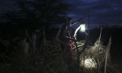 A Maasai man puts up a newly obtained solar lamp to keep predators away from the herds, in the village of Koora, Kenya, Tuesday, August 18, 2015. That day, in this small village, a local NGO came to give them solar power for the first time ever. Up until then there was no light at night for children to study by, or to keep the herds safe. Many people in Africa don't have access to power in their homes and will walk many miles to charge their cell phones. In Kenya people almost can't live without their mobiles, they use it to pay for most things and connect with the world -- they use their mobiles instead of physical money, which is a lot safer and more practical. In nearly every location globally, at every demographic level, people possess some form of cell phone in todayÕs hyper connected world. Be it an iPhone or the simplest Nokia, the anxiety born of a fading battery has emerged as a common human experience. In villages, slums and any poorer area of Africa, charging stations have become the central social circles. The consequences of lost connections are palatable in Kenya, and the opportunities and growth that come with access to reliable power is transformative. (Photo credit/Tara Todras-Whitehill)