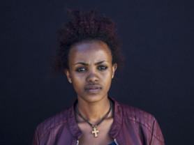 Rita Yemane, 18, from Eritrea, poses for a portrait in the Kara Tepe camp in Lesbos, Greece, Sept. 29, 2016. (Photo credit, Tara Todras-Whitehill/ Vignette Interactive for the IRC) Rita- On my journey, I was abused by men. The sea was difficult, [it was a] bad experience. Now I want an education. My dream is to support my elderly mother. I haven't found a solution yet. We aren't helped with problems here. We didn't want to leave Eritrea, but the leaders are bad for people. Everyone is forced to go to [a military training academy called] Sawa after grade eight. That is why I came here. Now I want to continue my education.