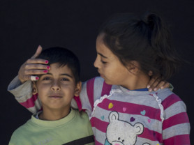 Reema Talib 10, right, and Amir Talib 7, siblings from Homs, Syria, pose for a portrait in the Kara Tepe camp in Lesbos, Greece, Sept. 29, 2016. (Photo credit, Tara Todras-Whitehill/ Vignette Interactive for the IRC) Reema- My name is Reema. My dream in Syria was to study and get educated. The war started and schools are no longer there. I came here. Now I wish to go to a safe country, study and get educated. Amir- My name is Amir. I was wishing to study in Syria, but the war started and I wasn't able to. We came here. We got locked here. I was wishing that we would study and get educated. Now I wish that we travel to some safe country and get educated.