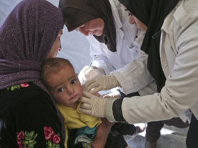 A child gets checked by a doctor at an MMU provided by Beyond, a UNICEF partner, at an IS near Zahle, Lebanon, January 13, 2016. (Photo Credit/Tara Todras-Whitehill for UNICEF)