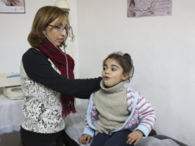 A doctor gives a checkup at a clinic, near Tyre, Lebanon, January 14, 2016. (Photo Credit/Tara Todras-Whitehill for UNICEF)