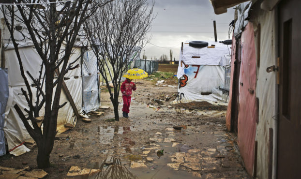 A girl walks with an umbrella inside an IS near Zahle, northern Lebanon, Tuesday, January 19, 2016. (Photo Credit/Tara Todras-Whitehill for UNICEF)