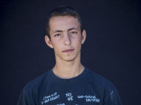 Twana Aziz, 15, from Sulaymaniyah, Iraq, poses for a portrait in the Kara Tepe camp in Lesbos, Greece, Sept. 29, 2016. (Photo credit, Tara Todras-Whitehill/ Vignette Interactive for the IRC) Twana- Our life was challenging in Iraq. We didn't have school. We didn't have money. ISIS was on the borders and life was really difficult. Our leaders weren't good and they were serving their own ends. So we left our country to Mytilene . We want to leave here for a good country and settle there. I want to live a happy life and pursue my future.