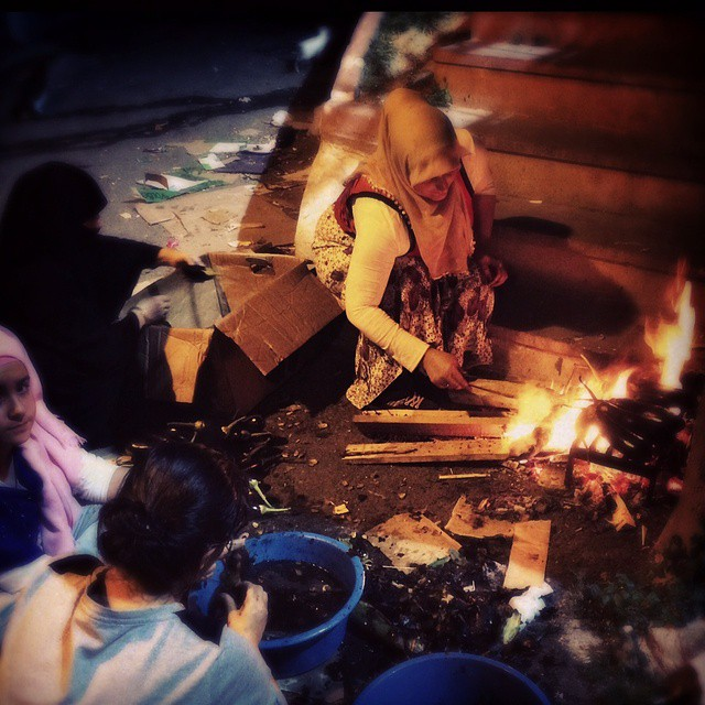 Turkish women roast eggplants in an small street off of #Istiklal in #Istanbul #Turkey. Photo by @taratwphoto Tara Todras-Whitehill #latergram #instagood #photooftheday  #eggplants #women #cooking #alley #alleyway #fire #roasting#picoftheday