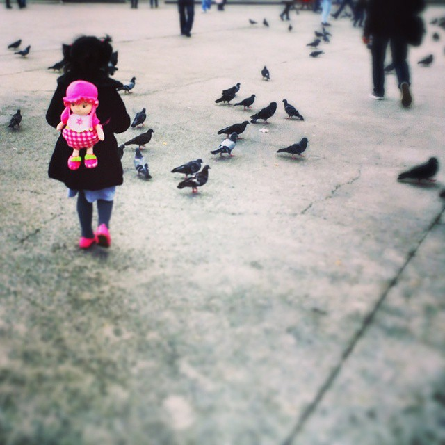 A little girl chases pigeons in #Taksim while wearing a pink #doll backpack in #Istanbul. Photo by @taratwphoto Tara Todras-Whitehill #latergram #instagood #photooftheday #pink #backpack #pigeons #birds #girl #feedthebirds #picoftheday