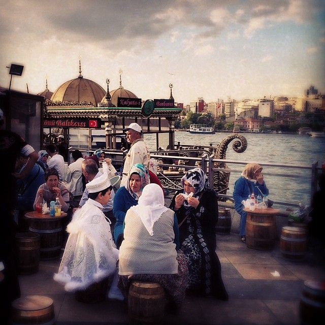 Turks eat fish sandwiches next to the #Galata #bridge in #Istanbul #Turkey before #sunset. Photo by @taratwphoto